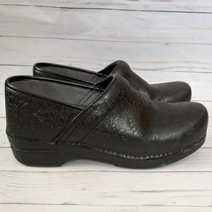 Dansko XP 2.0 Black Floral Tooled Clogs